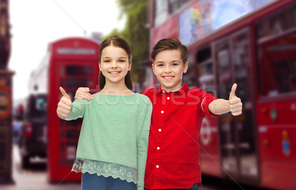happy children showing thumbs up over london city Stock photo © dolgachov