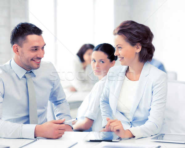 Colleghi parlando ufficio foto business computer Foto d'archivio © dolgachov