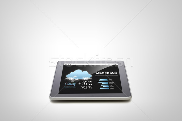 close up of tablet pc computer with weather cast Stock photo © dolgachov