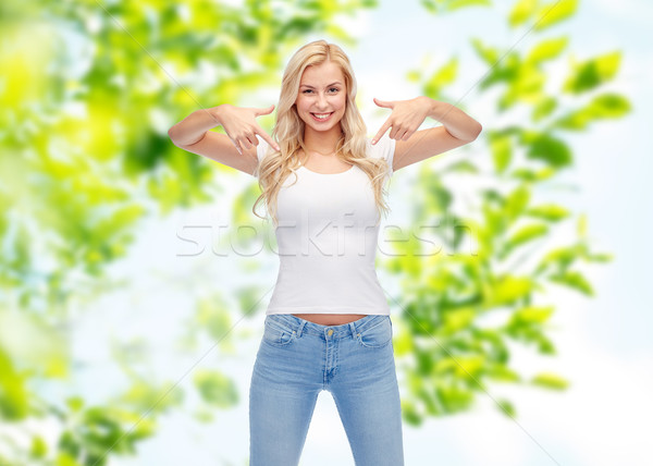 happy young woman or teenage girl in white t-shirt Stock photo © dolgachov