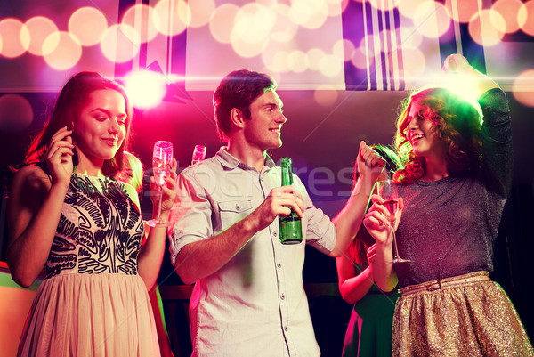 Mosolyog barátok borospoharak sör klub buli Stock fotó © dolgachov