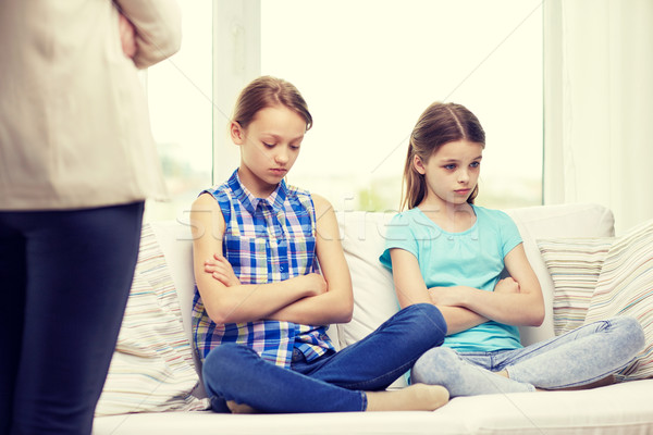 upset guilty little girls sitting on sofa at home Stock photo © dolgachov