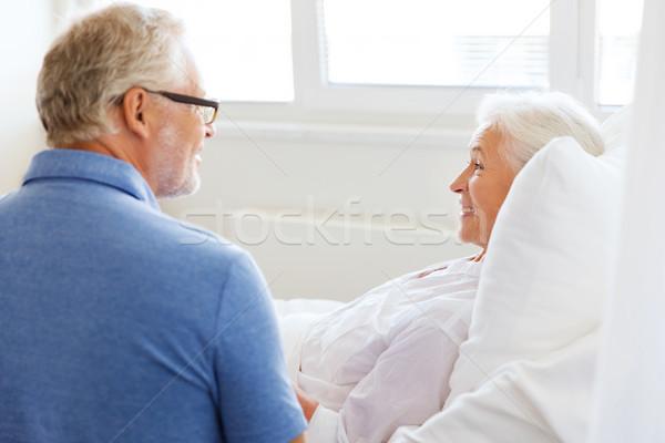 senior couple meeting at hospital ward Stock photo © dolgachov