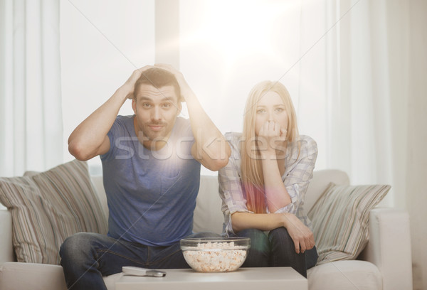 upset couple after sports team loss Stock photo © dolgachov