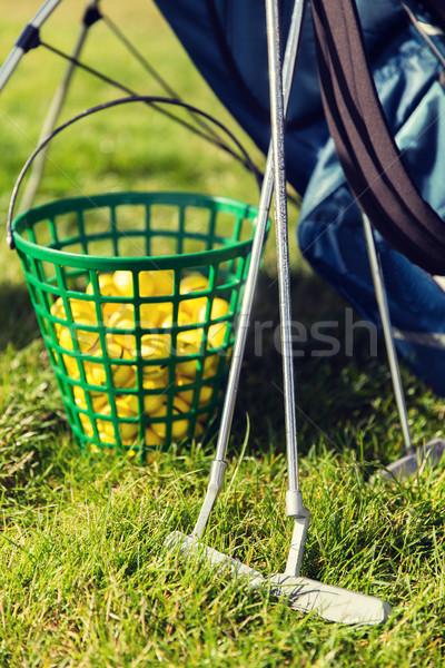 Közelkép golf klub golyók kosár fű Stock fotó © dolgachov