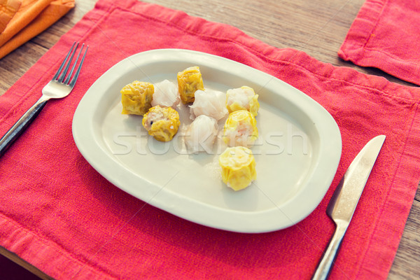 plate of spring rolls with rice on table Stock photo © dolgachov