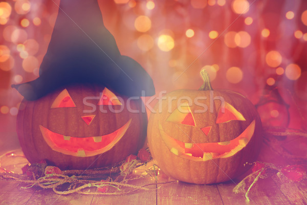 close up of carved halloween pumpkins on table Stock photo © dolgachov