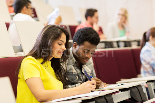 group of students with notebooks in lecture hall Stock photo © dolgachov