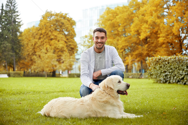 happy man with labrador dog in autumn city park Stock photo © dolgachov