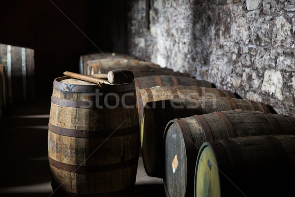 Stock photo: close up of old wooden barrel in wine cellar