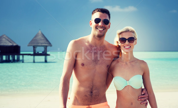 happy couple in swimwear hugging on summer beach Stock photo © dolgachov