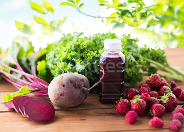bottle with beetroot juice, fruits and vegetables Stock photo © dolgachov