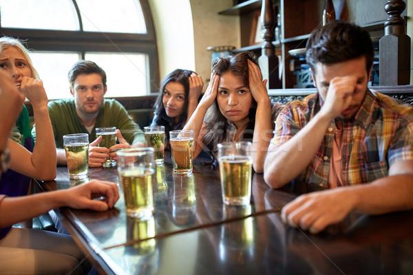 Amis bière regarder football bar pub Photo stock © dolgachov