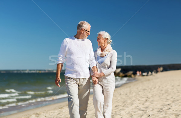 счастливым , держась за руки лет пляж семьи Сток-фото © dolgachov