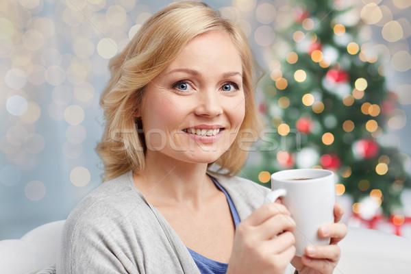 Felice donna Cup tè caffè Natale Foto d'archivio © dolgachov
