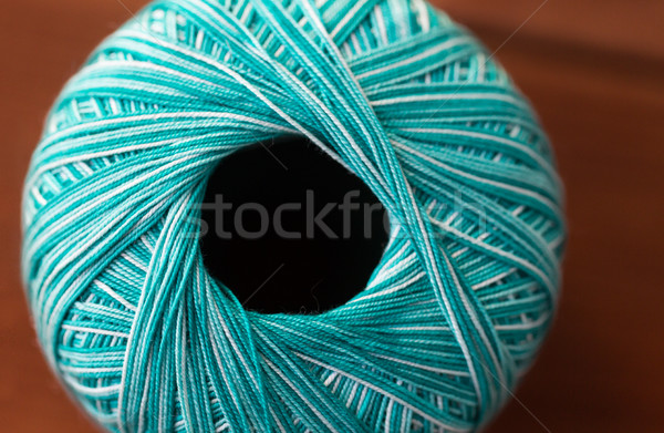 close up of turquoise knitting yarn ball on wood Stock photo © dolgachov