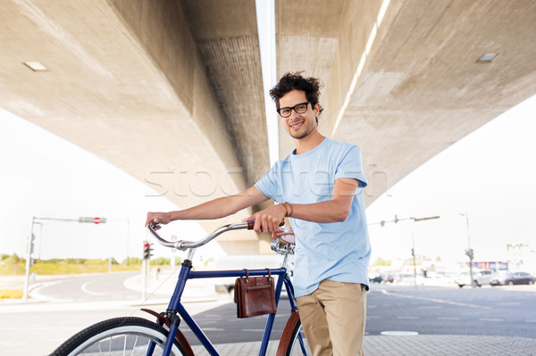 Adam sabit dişli bisiklet köprü Stok fotoğraf © dolgachov