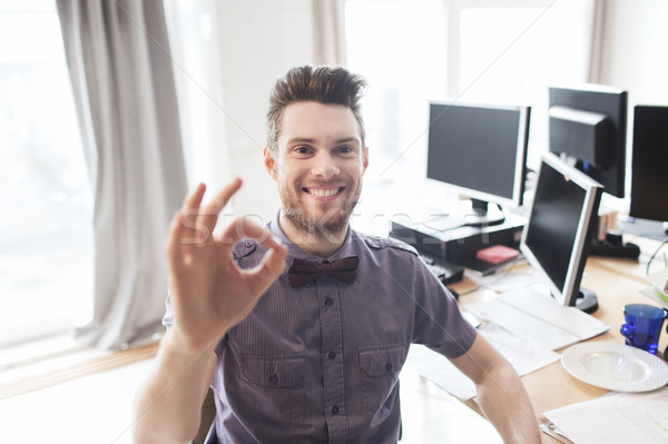 happy creative male office worker showing ok sign Stock photo © dolgachov