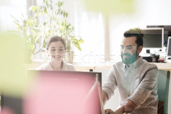Stock photo: happy creative team with computer in office