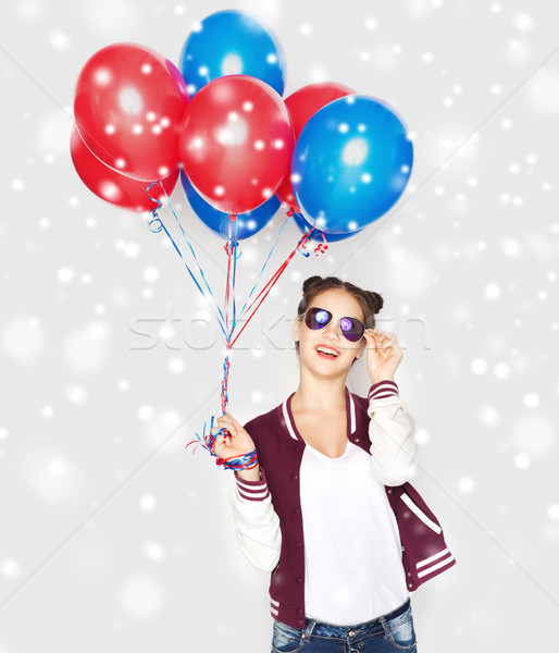 happy teenage girl with helium balloons over snow Stock photo © dolgachov