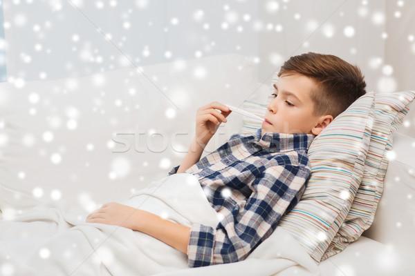 Ragazzo influenza termometro home malattia Foto d'archivio © dolgachov