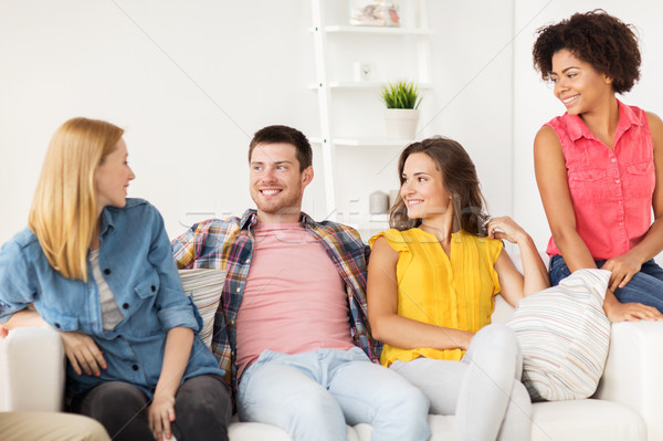 group of happy friends talking at home Stock photo © dolgachov