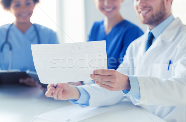 close up of doctors with cardiogram at hospital  Stock photo © dolgachov