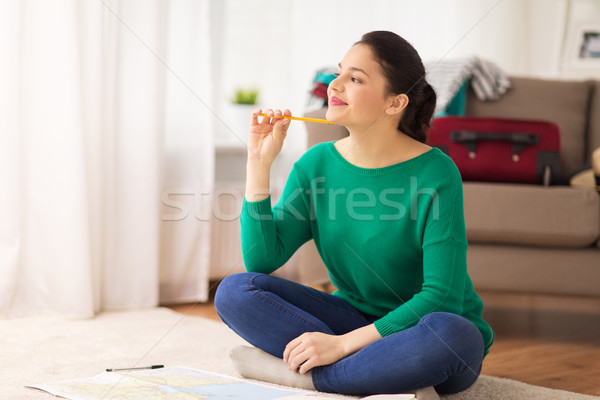 happy young woman with travel map at home Stock photo © dolgachov