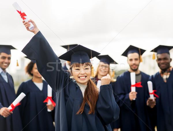 Gelukkig student diploma vieren afstuderen onderwijs Stockfoto © dolgachov