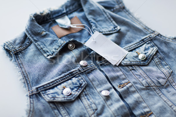 close up of denim waistcoat with price tag Stock photo © dolgachov