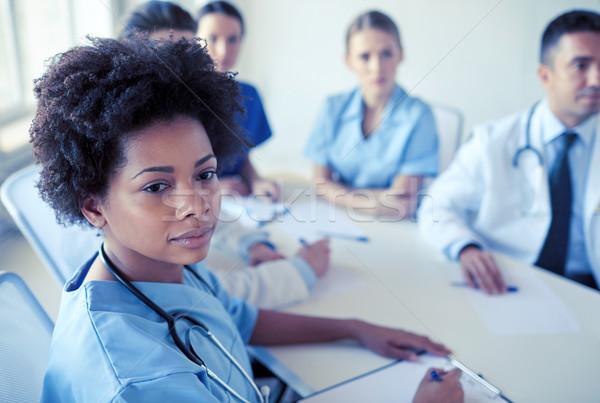 female doctor over group of medics at hospital Stock photo © dolgachov
