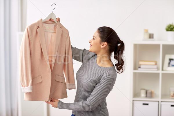 happy woman with jacket at home Stock photo © dolgachov
