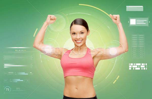 幸せ スポーティー 女性 上腕二頭筋 フィットネス ストックフォト © dolgachov