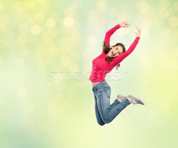 Mutlu genç kadın atlama hava dans mutluluk Stok fotoğraf © dolgachov