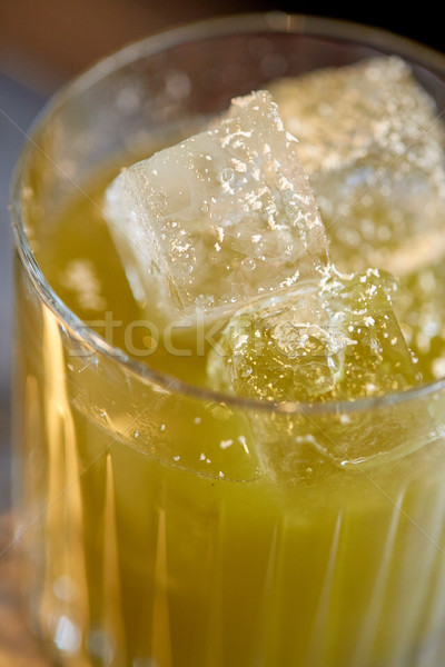 close up of glass with cocktail at bar Stock photo © dolgachov