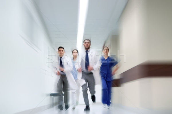 group of medics walking along hospital Stock photo © dolgachov