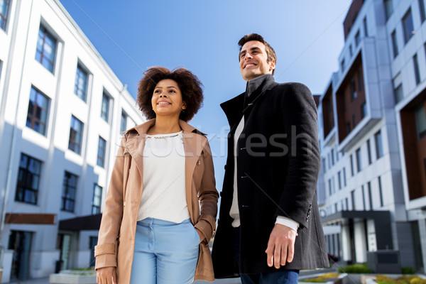 Boldog nemzetközi férfi nő figyelmeztetés üzletemberek Stock fotó © dolgachov