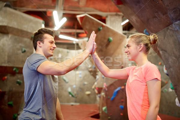 happy man and woman at indoor climbing gym wall Stock photo © dolgachov