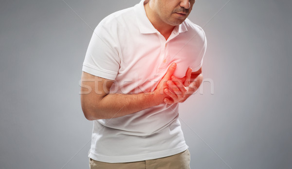 close up of man suffering from heart ache Stock photo © dolgachov