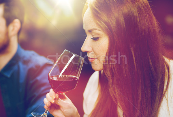 smiling woman drinking red wine at restaurant Stock photo © dolgachov