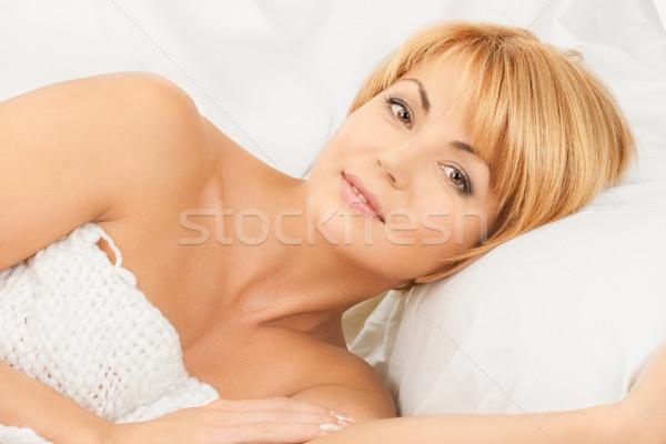 woman in bed Stock photo © dolgachov