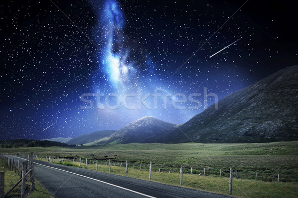 night landscape of road and mountains over space Stock photo © dolgachov