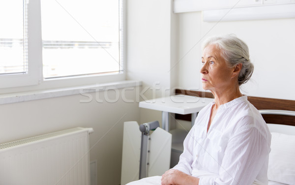 sad senior woman sitting on bed at hospital ward Stock photo © dolgachov