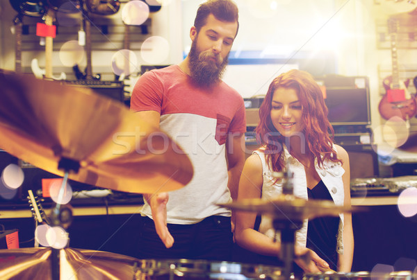 Couple musiciens tambour musique magasin Photo stock © dolgachov