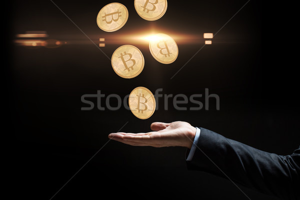 close up of businessman hand with bitcoins Stock photo © dolgachov