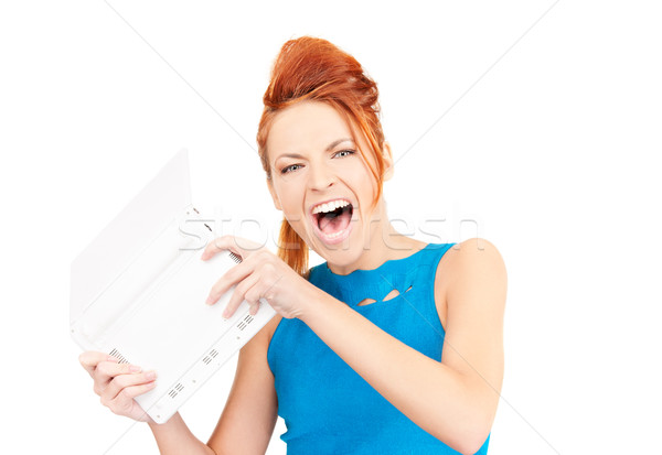 angry woman with laptop computer Stock photo © dolgachov