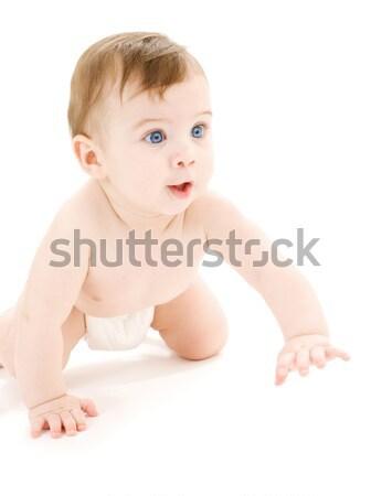 Kúszás baba fiú felfelé néz fényes kép Stock fotó © dolgachov