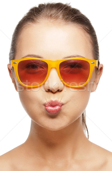 funny teenage girl in shades Stock photo © dolgachov