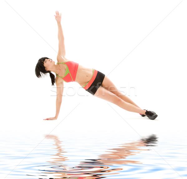 woman practicing ashtanga yoga posture Stock photo © dolgachov