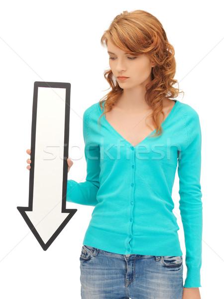 Genç kız yön ok işareti resim çekici iş Stok fotoğraf © dolgachov